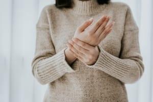 woman-holding-hand-arthritis-pain