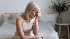 woman-holding-head-chronic-pain